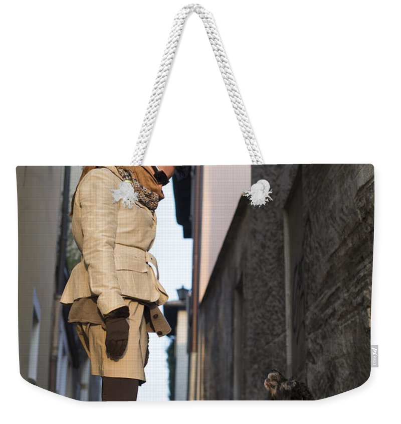 Woman Weekender Tote Bag featuring the photograph Woman Speak With Her Dog by Mats Silvan