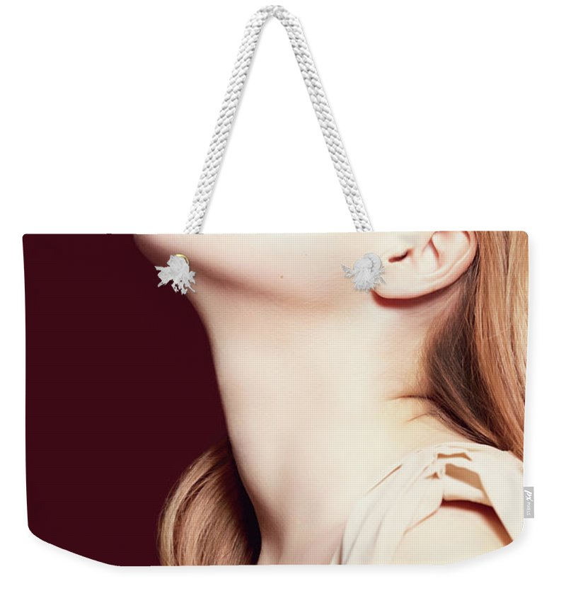 People Weekender Tote Bag featuring the photograph Woman Wearing Hat by Iconogenic