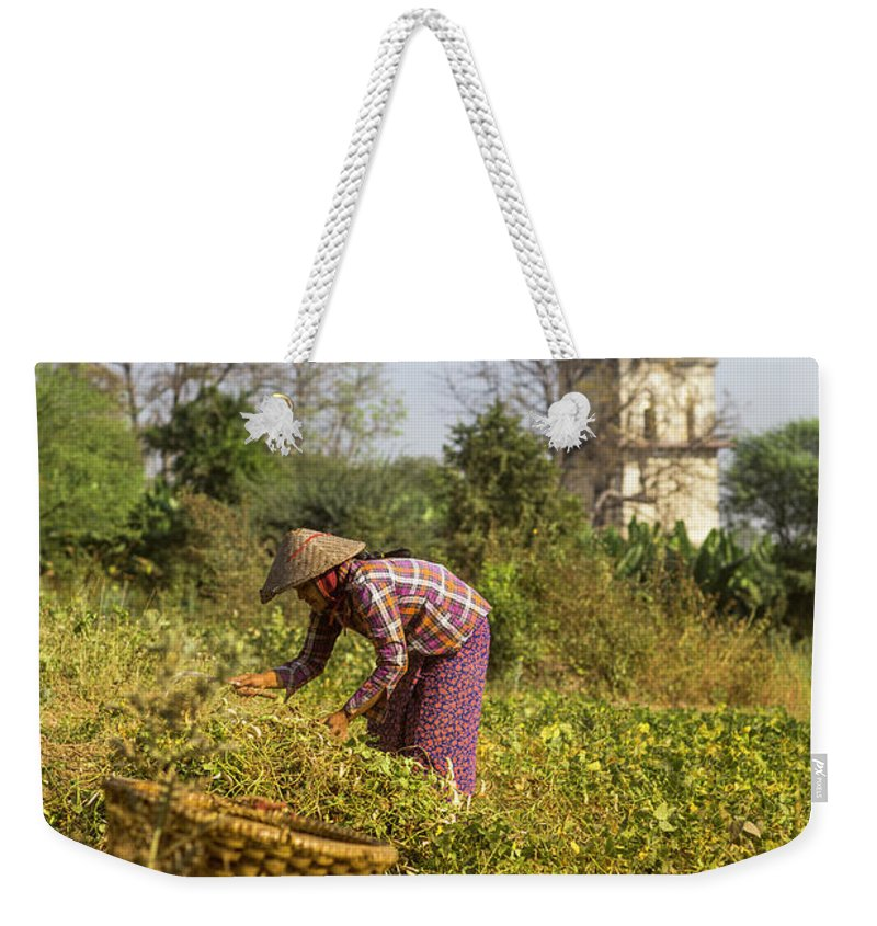 Three Quarter Length Weekender Tote Bag featuring the photograph Woman Weeding At Nanmyin Tower by Merten Snijders
