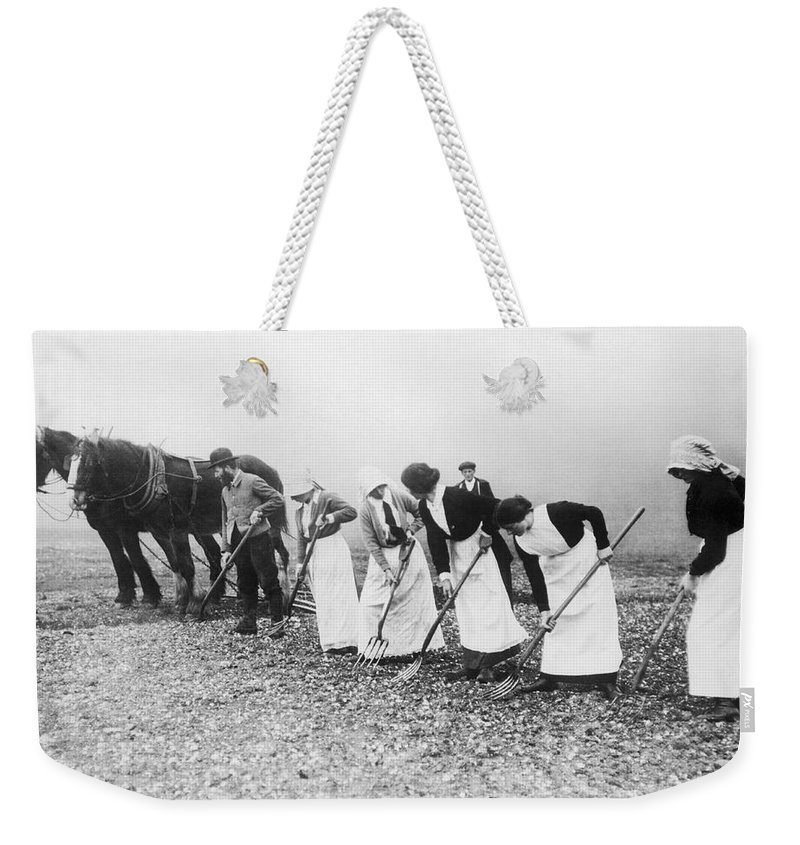 1035-842 Weekender Tote Bag featuring the photograph Women Learning Farming by Underwood Archives