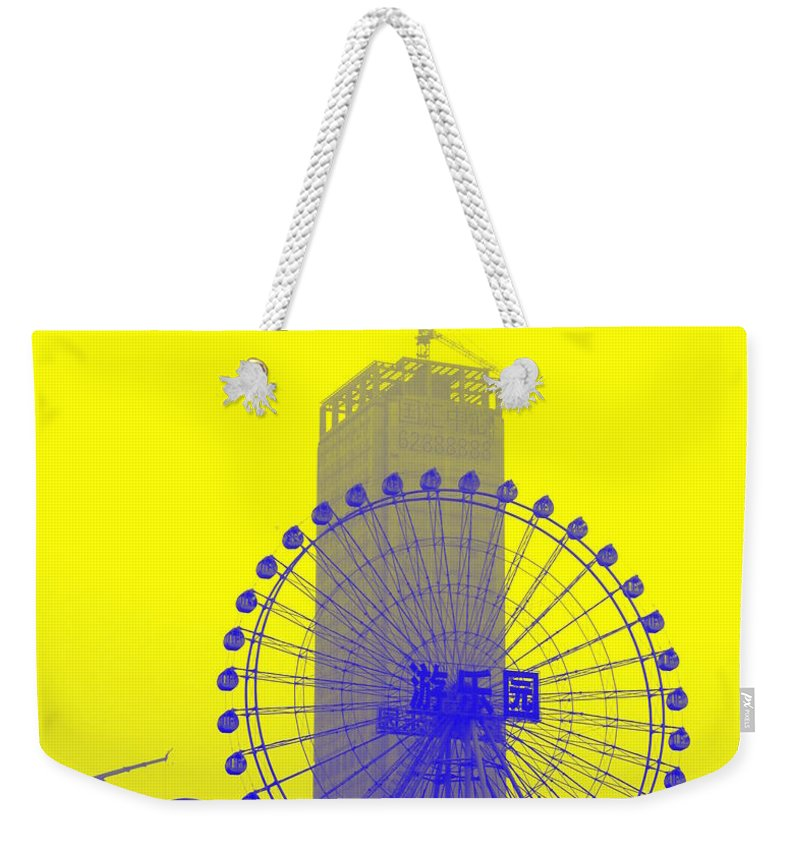 Wonder Weekender Tote Bag featuring the photograph Wonderwheel In Blue And Yellow by Valentino Visentini