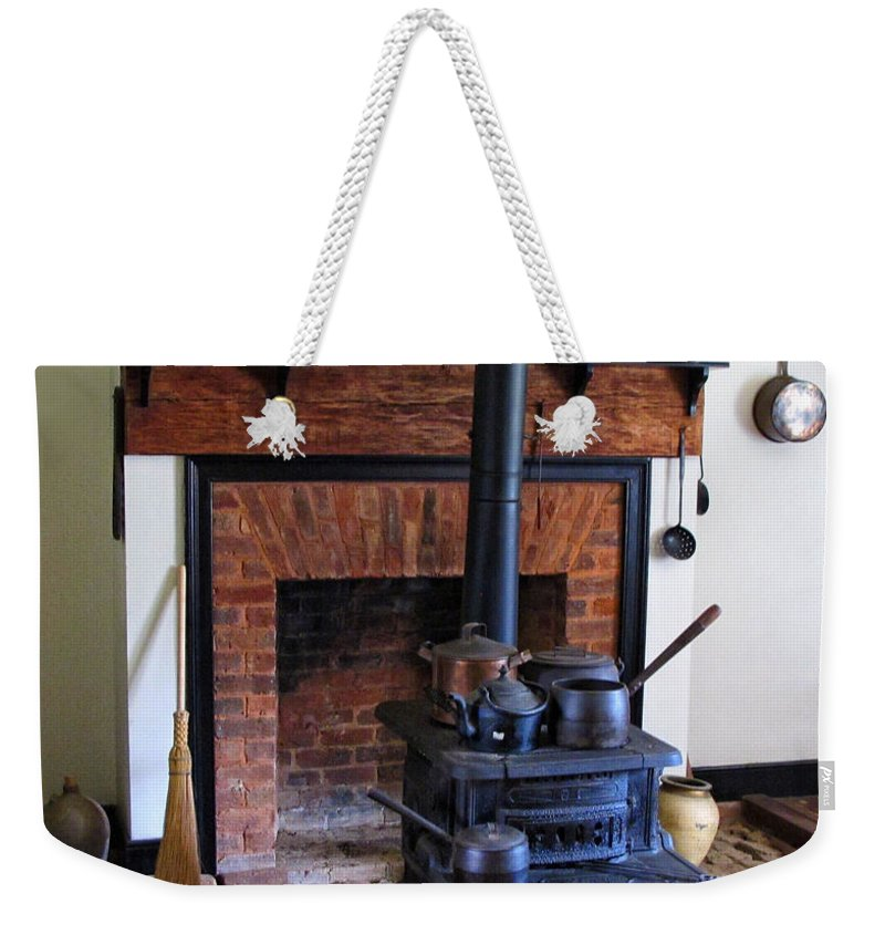 Wood Burning Stove Weekender Tote Bag featuring the photograph Wood Burning Stove by Dave Mills