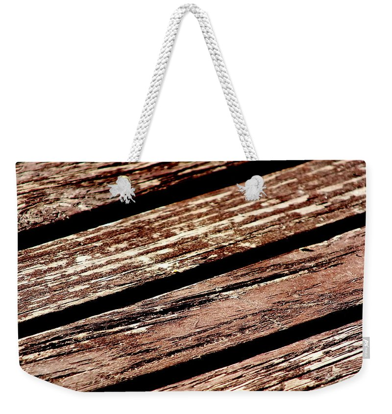 Wood Timber Brown Deck Porch Veranda Grain Diagonal Flaking Weekender Tote Bag featuring the photograph Wooden Deck by Guy Pettingell