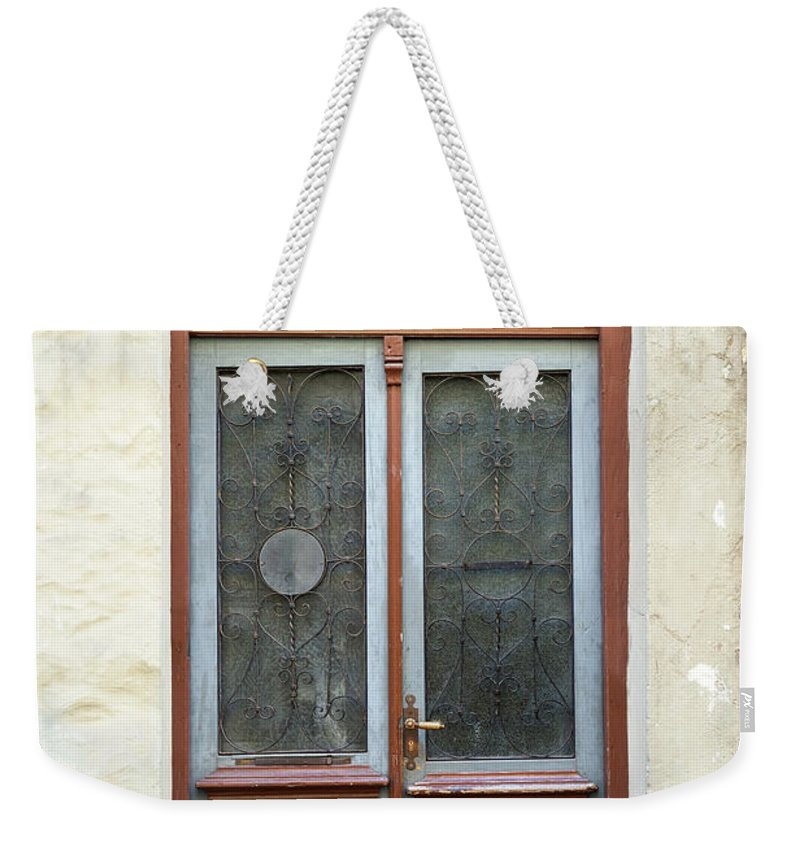 Rectangle Weekender Tote Bag featuring the photograph Wooden Door With Glass And Decoration by Eugenesergeev