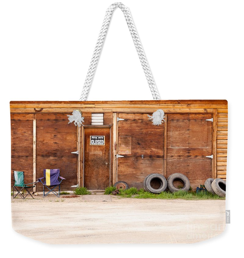 Abandoned Weekender Tote Bag featuring the photograph Wooden Gate Of Rural Timber Building Closed Sign by Stephan Pietzko