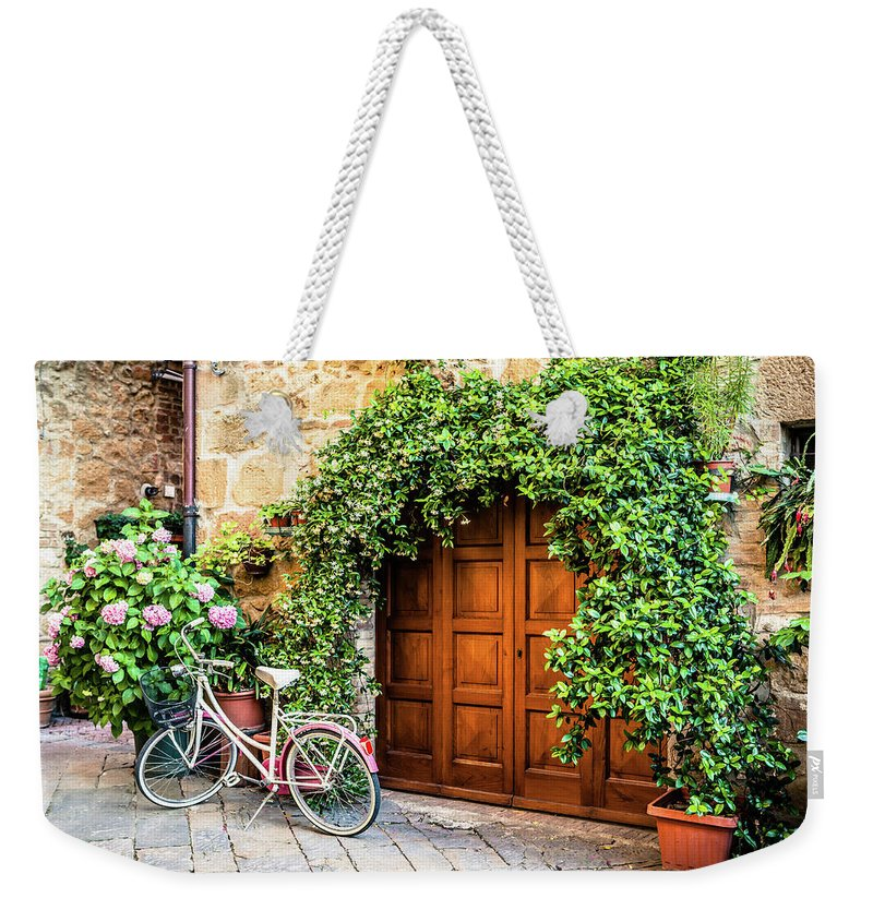 Val D'orcia Weekender Tote Bag featuring the photograph Wooden Gate With Plants In An Ancient by Giorgiomagini