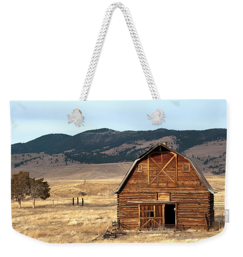 Scenics Weekender Tote Bag featuring the photograph Wooden Hut In The Countryside Of by Feifei Cui-paoluzzo