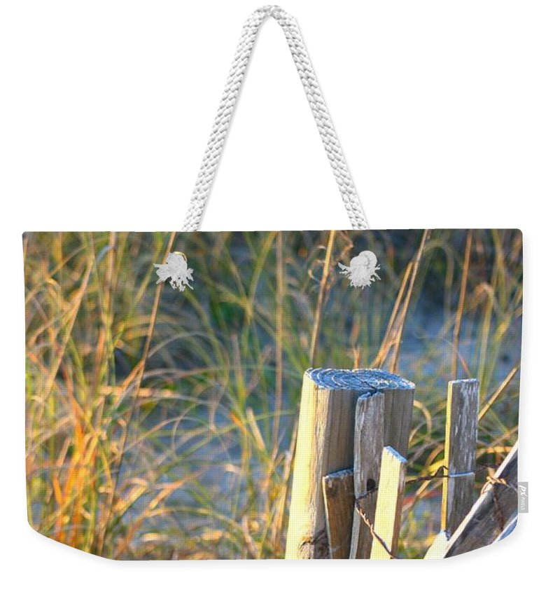 Post Weekender Tote Bag featuring the photograph Wooden Post And Fence At The Beach by Nadine Rippelmeyer
