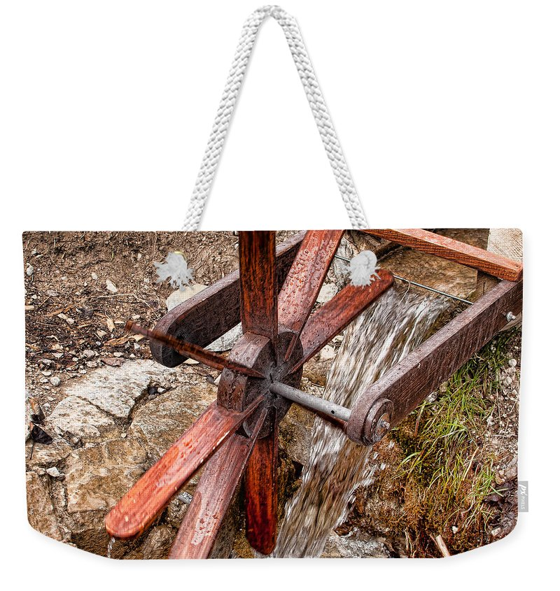 Wood Weekender Tote Bag featuring the photograph Wooden Water Wheel by Les Palenik
