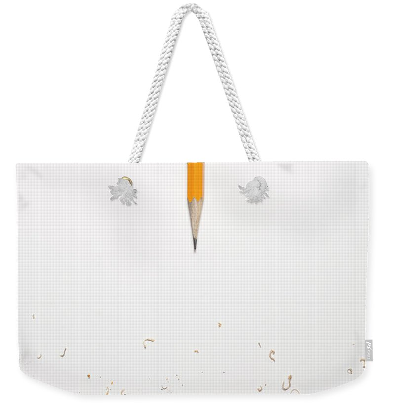 White Background Weekender Tote Bag featuring the photograph Worn Down Pencil With Shaving by Chris Parsons