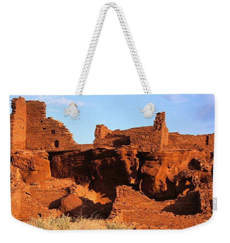 Arizona Weekender Tote Bag featuring the photograph Wupatki Sunrise 1 by Tom Daniel