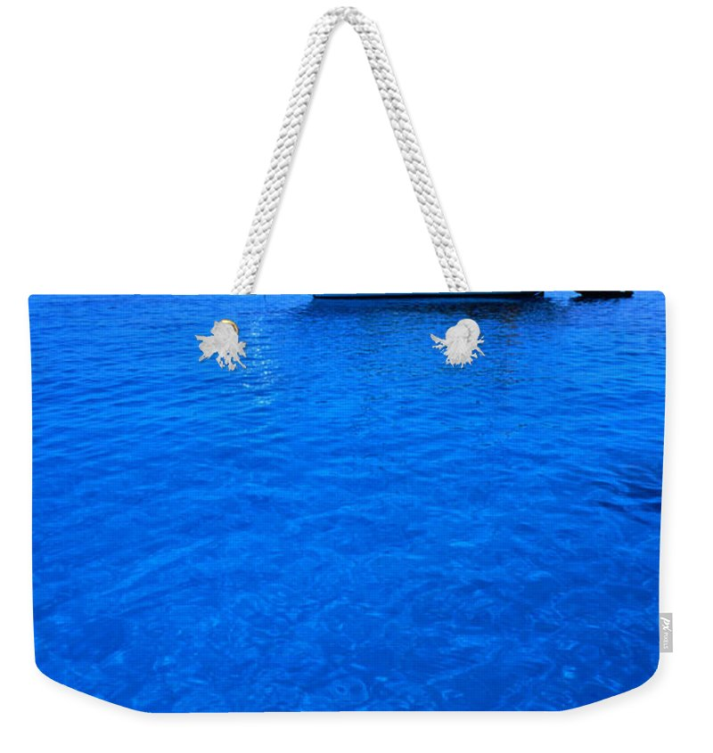 Freight Transportation Weekender Tote Bag featuring the photograph Yacht Anchored In The Spectacular by Dallas Stribley
