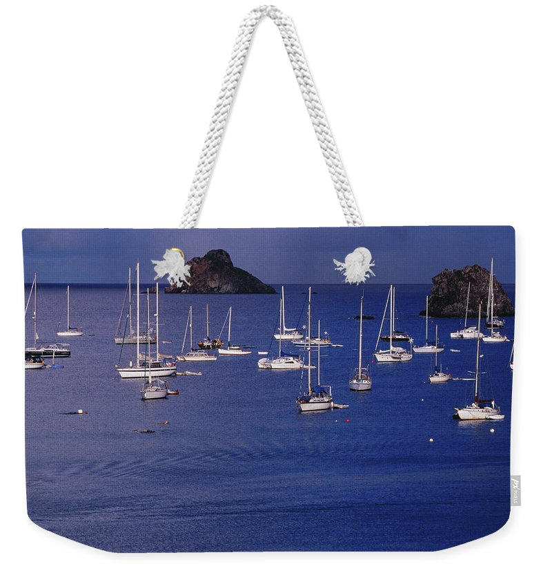 Sailboat Weekender Tote Bag featuring the photograph Yachts Moored On The Caribbean Sea Near by Richard I'anson