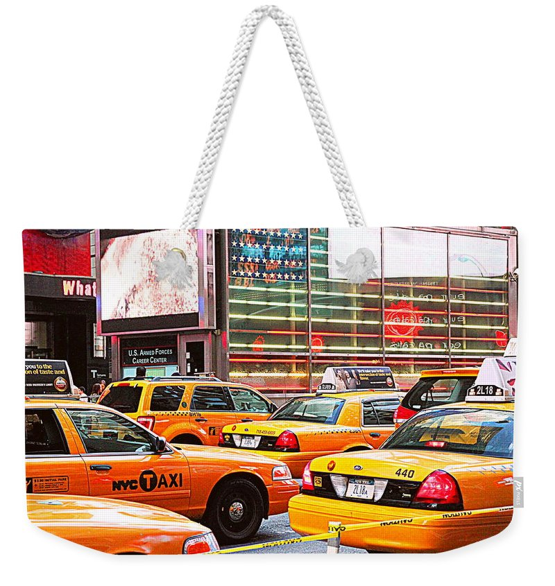 Taxi Weekender Tote Bag featuring the photograph Yellow Cabs by Valentino Visentini