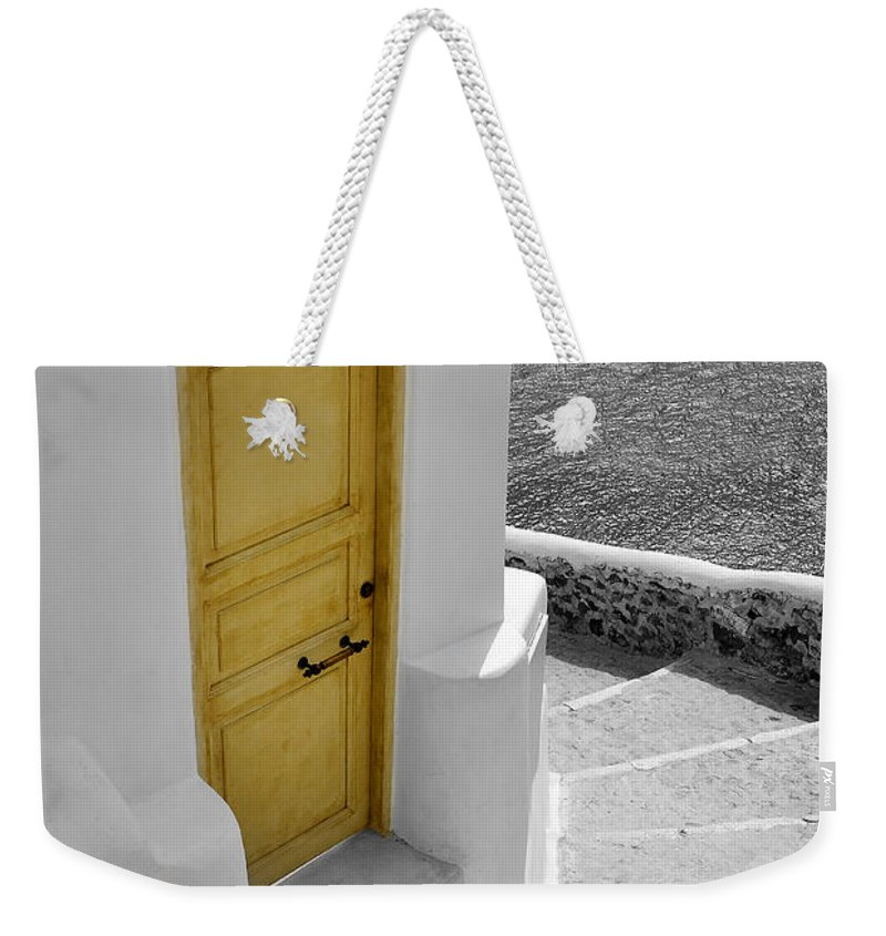 Island Weekender Tote Bag featuring the photograph Yellow Door Of Oia by Jack Daulton