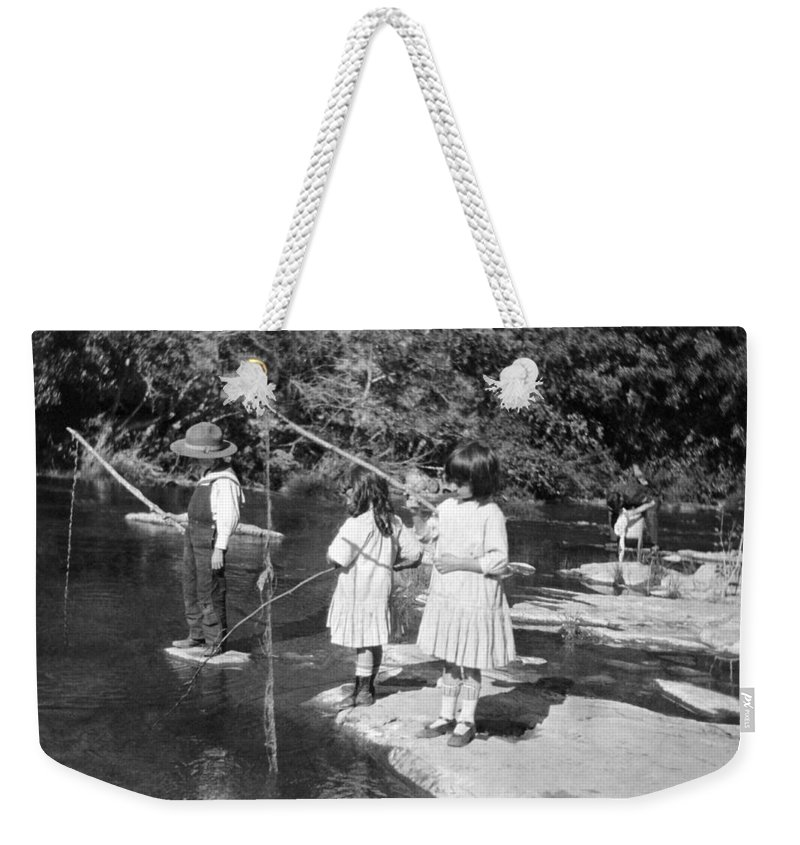 1910 Weekender Tote Bag featuring the photograph Young Children Fishing by Underwood Archives