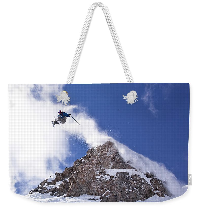 Action Weekender Tote Bag featuring the photograph Young Man Catches Huge Air While by Henry Georgi