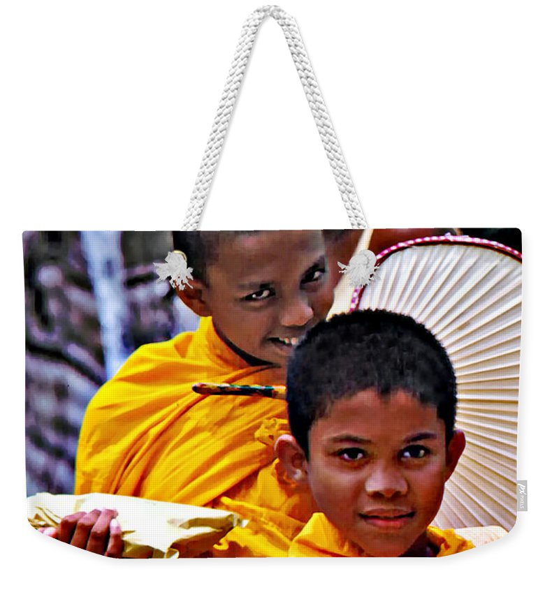Buddhism Weekender Tote Bag featuring the photograph Young Monks by Steve Harrington