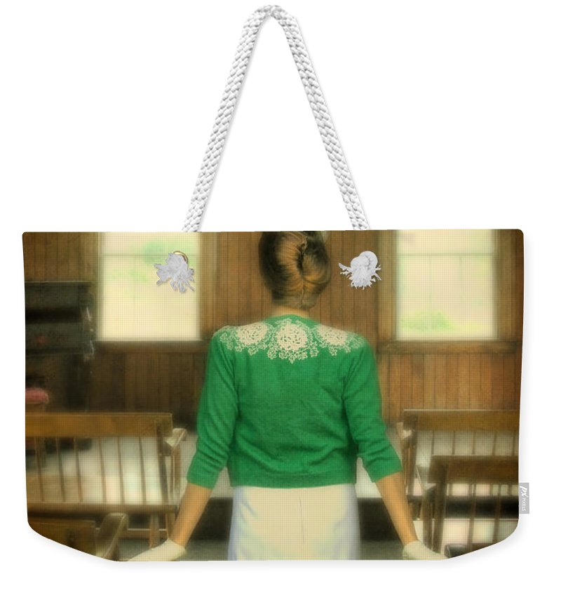 Lady Weekender Tote Bag featuring the photograph Young Woman Balancing A Book On Her Head by Jill Battaglia