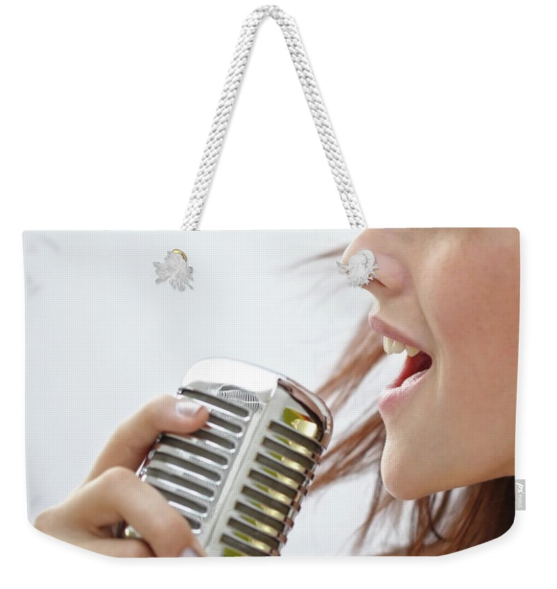 People Weekender Tote Bag featuring the photograph Young Woman Singing Into A Retro by Darren Robb