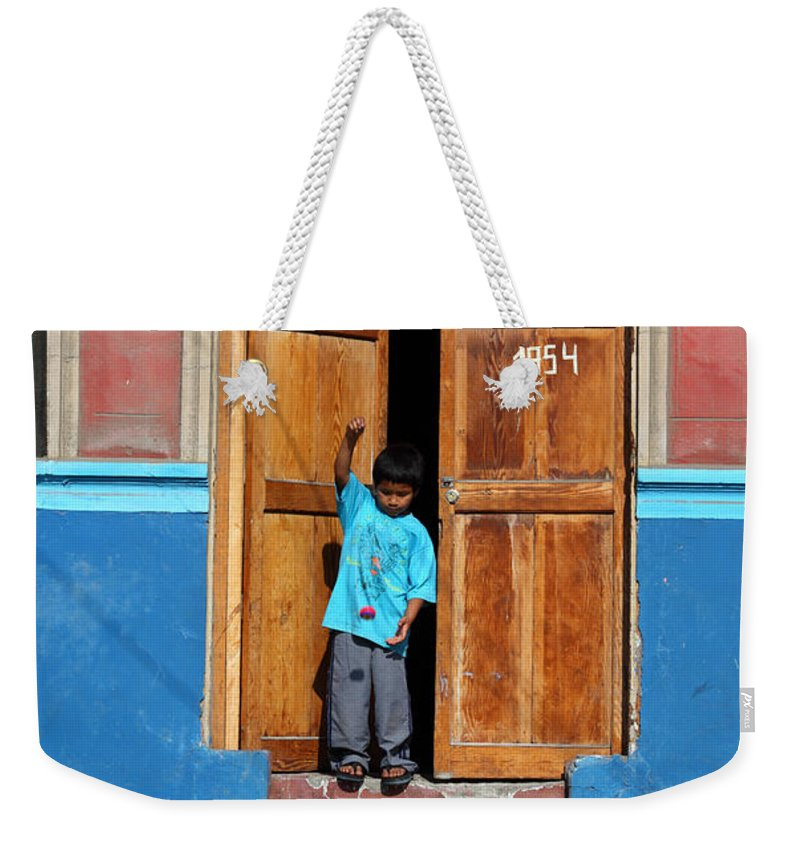 Childhood Weekender Tote Bag featuring the photograph Yoyo Fun by James Brunker