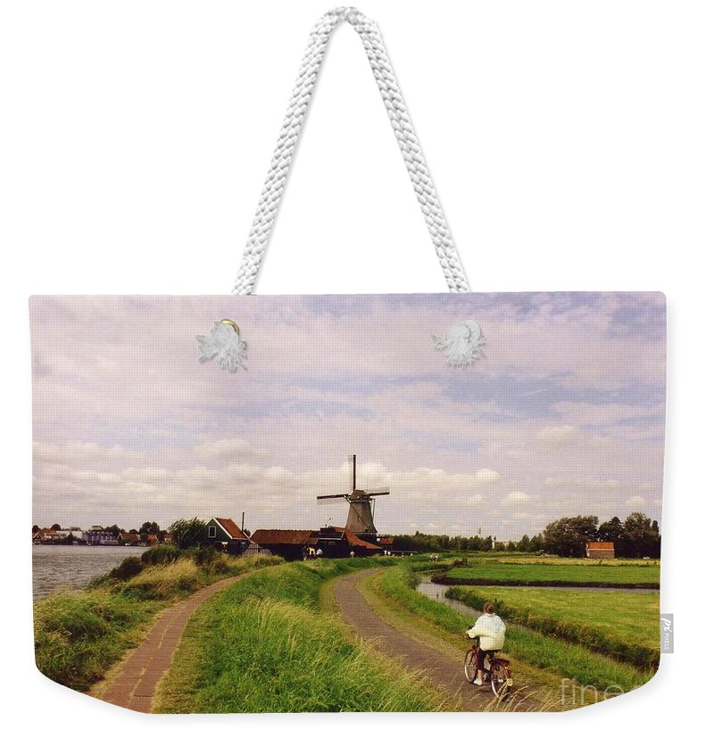Windmills Weekender Tote Bag featuring the photograph Zaanse Schans by John Malone