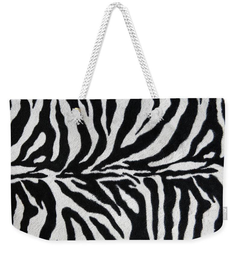 Animal Skin Weekender Tote Bag featuring the photograph Zebra Textile Background by Narvikk