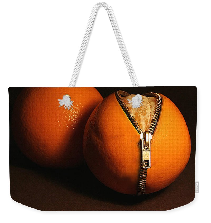 Idea Weekender Tote Bag featuring the photograph Zipped Oranges by Jaroslaw Blaminsky