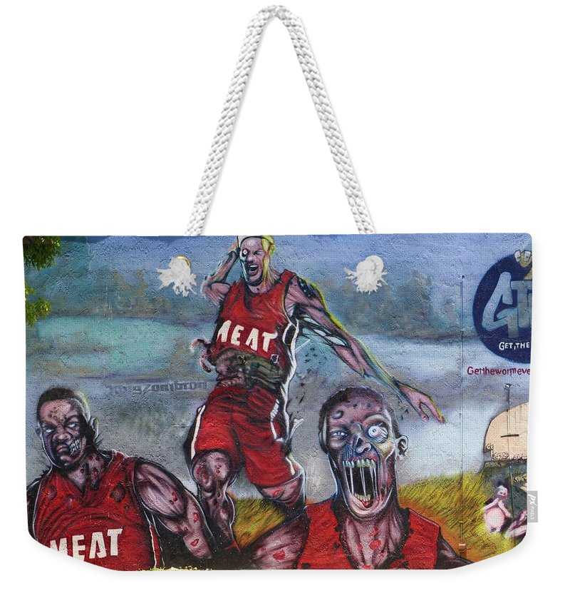 Eyes Weekender Tote Bag featuring the photograph Zombie Heat by Chuck Hicks