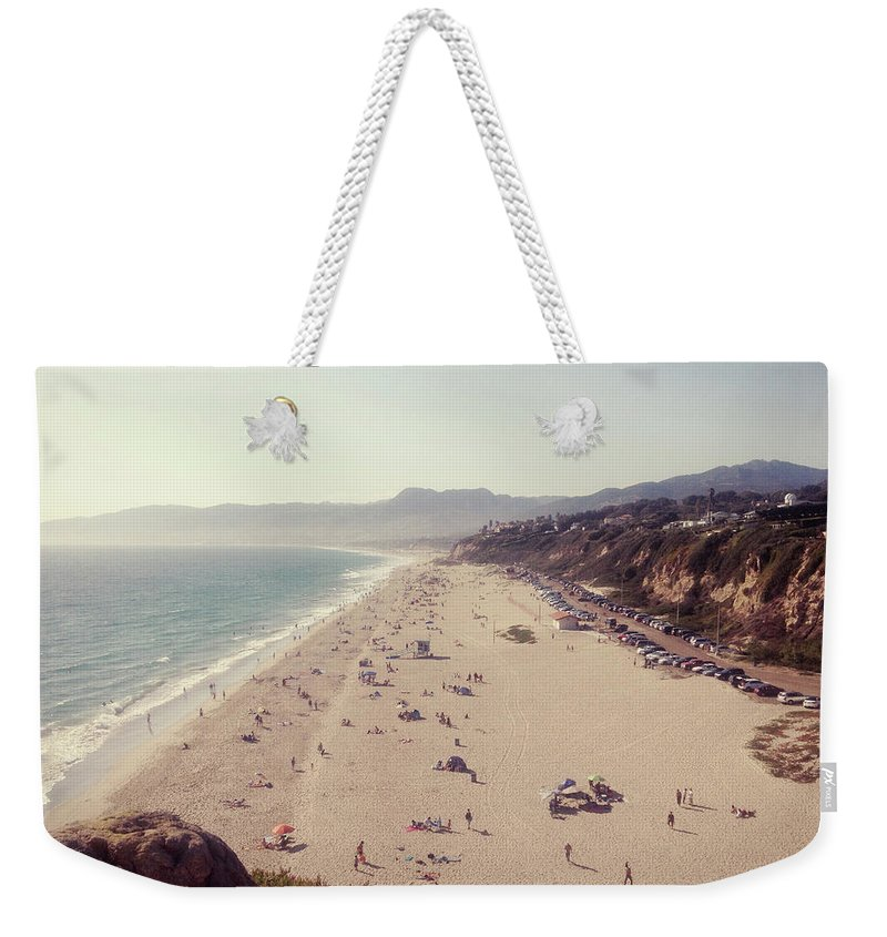 Water's Edge Weekender Tote Bag featuring the photograph Zuma Beach At Sunset Malibu, Ca by William Andrew