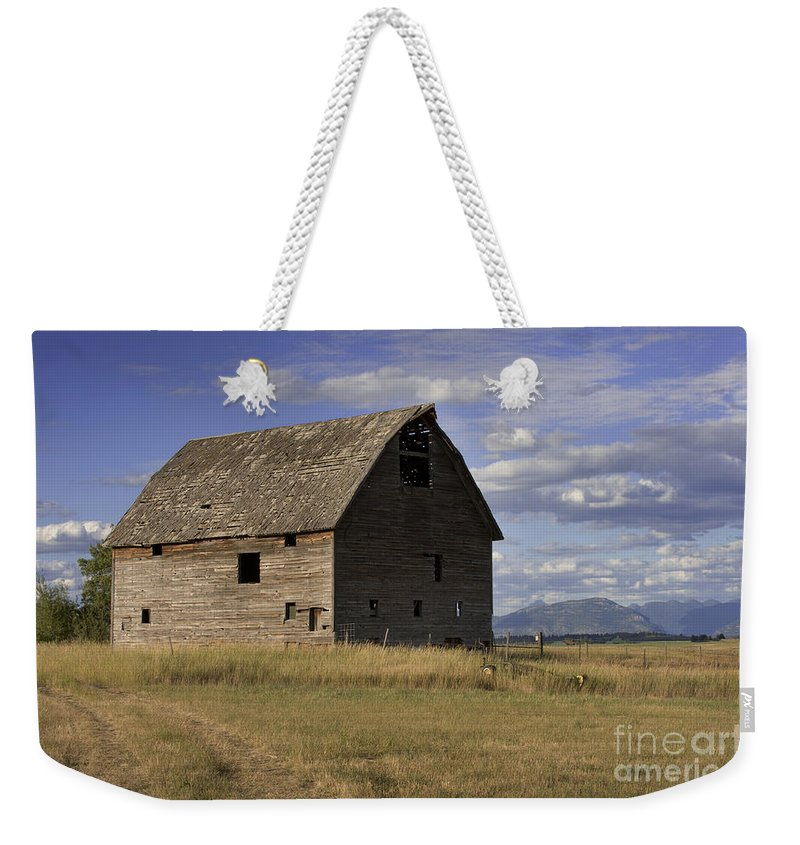 Big Sky Weekender Tote Bag featuring the photograph Old Big Sky Barn by Sandra Bronstein