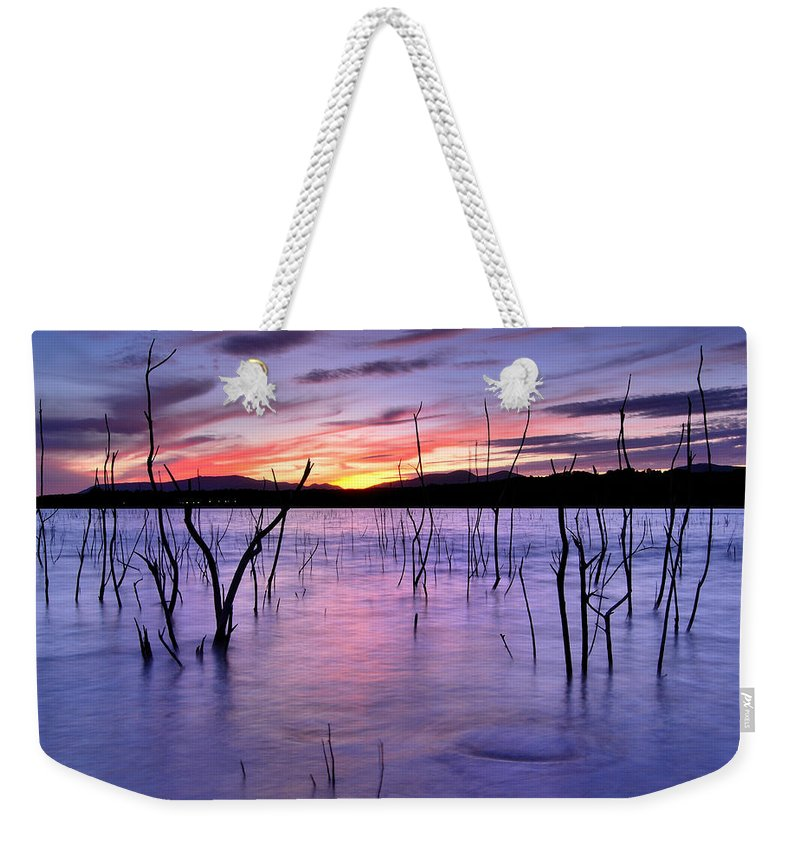 Sunset Weekender Tote Bag featuring the photograph Purple Lake by Guido Montanes Castillo