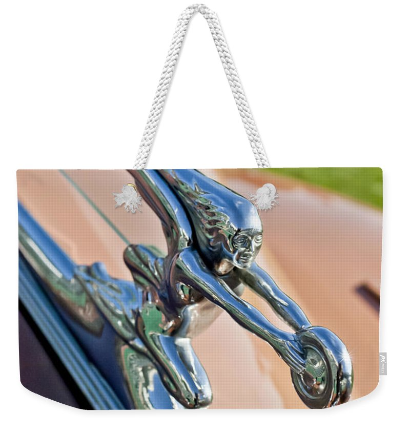 1942 Packard Darrin Convertible Victoria Weekender Tote Bag featuring the photograph 1942 Packard Darrin Convertible Victoria Hood Ornament by Jill Reger