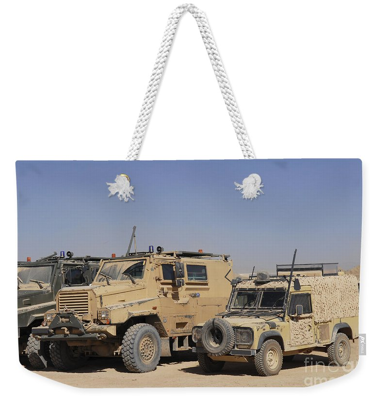 4x4 Weekender Tote Bag featuring the photograph A British Armed Forces Snatch Land by Andrew Chittock