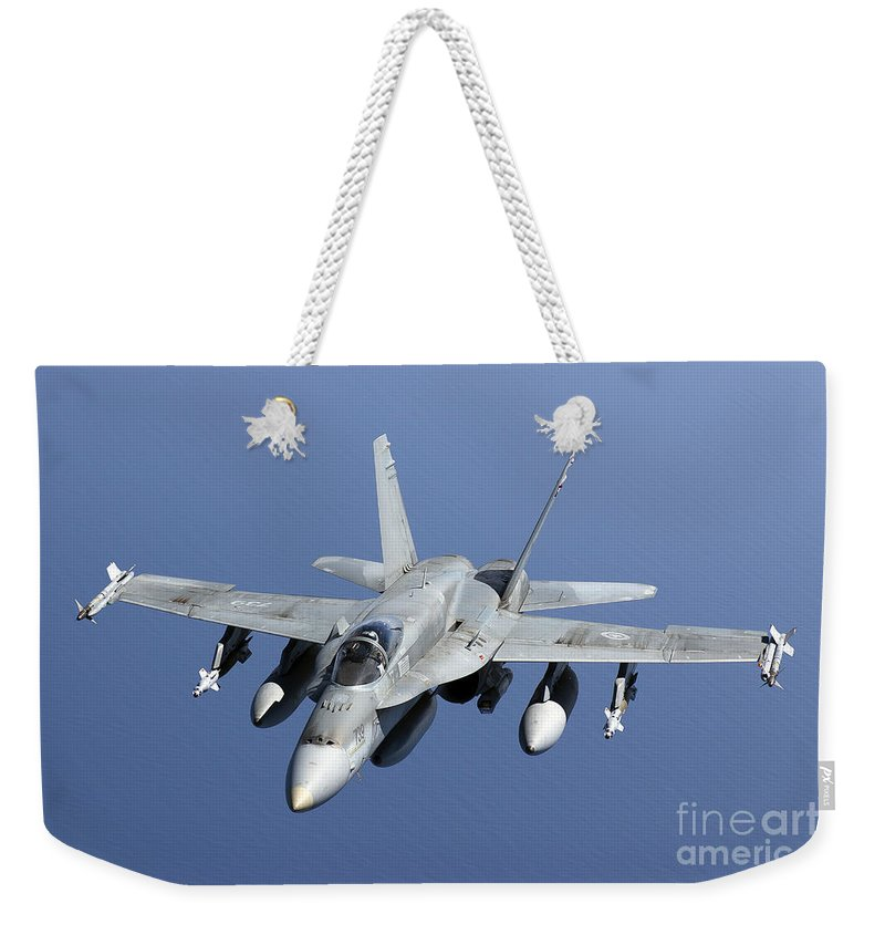 Libya Weekender Tote Bag featuring the photograph A Cf-188a Hornet Of The Royal Canadian by Gert Kromhout
