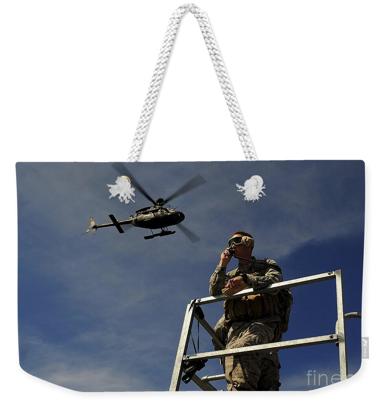 Communication Weekender Tote Bag featuring the photograph A Joint Terminal Attack Controller by Stocktrek Images