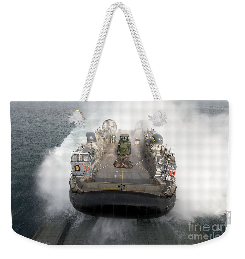 Military Weekender Tote Bag featuring the photograph A Landing Craft Air Cushion Enters by Stocktrek Images