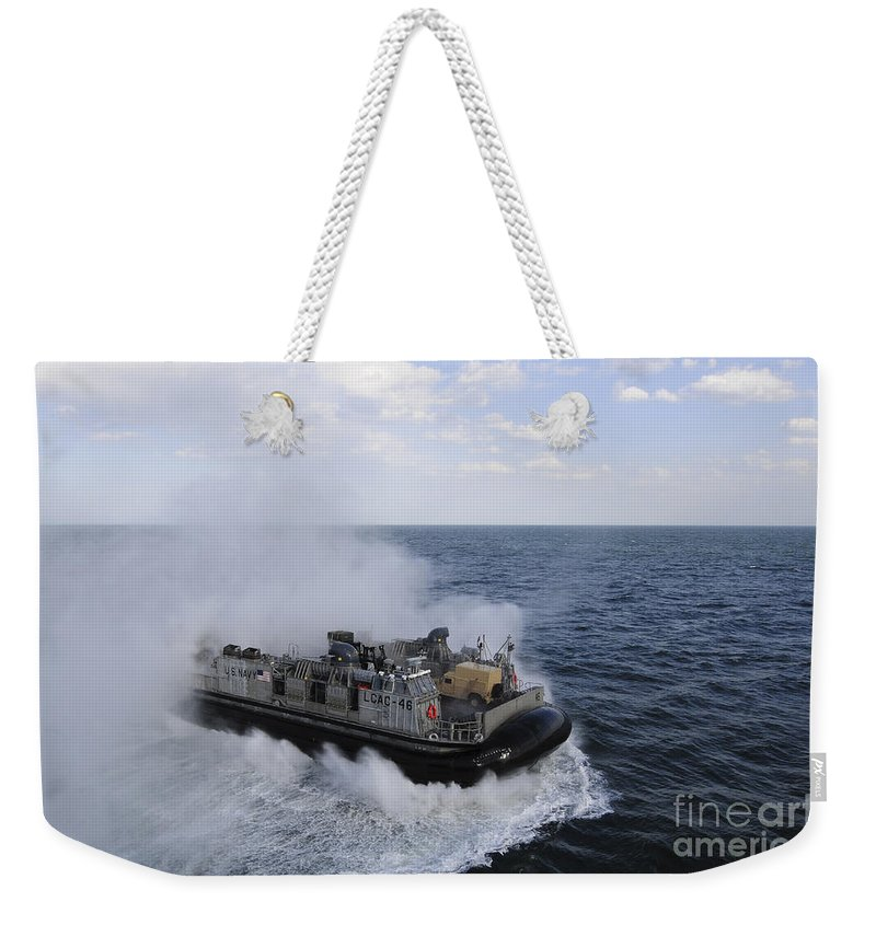 Military Weekender Tote Bag featuring the photograph A Landing Craft Utility From Assault by Stocktrek Images