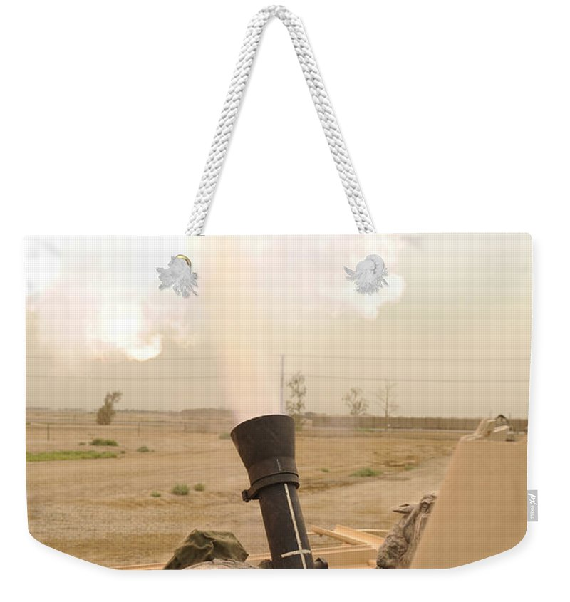 Iraq Weekender Tote Bag featuring the photograph A M120 Mortar System Is Fired by Stocktrek Images