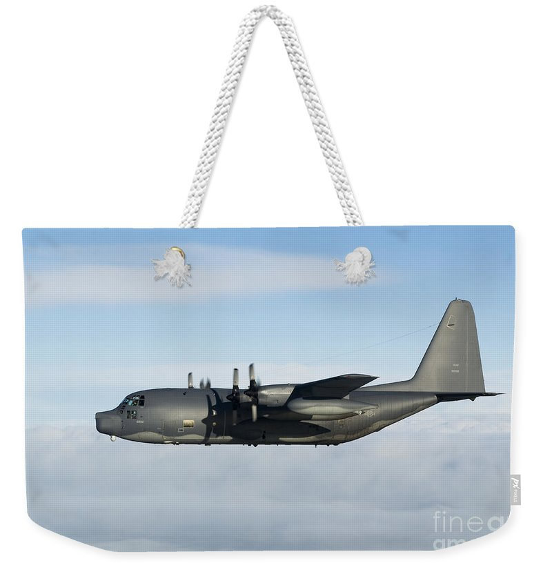 Transportation Weekender Tote Bag featuring the photograph A Mc-130p Combat Shadow In Flight by Gert Kromhout