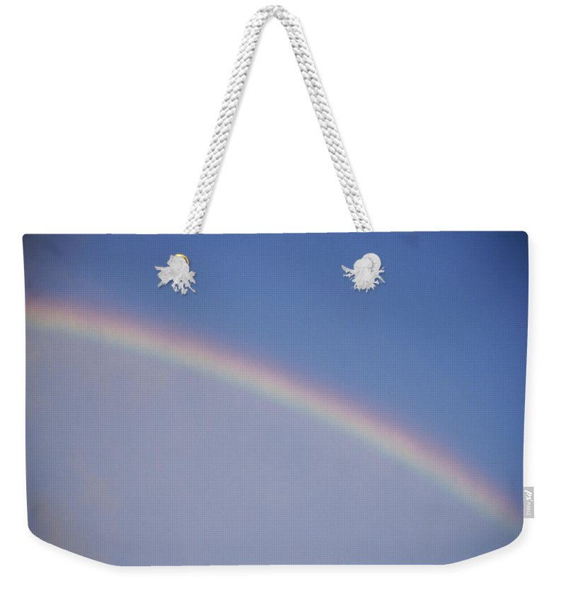 Natural Forces And Phenomena Weekender Tote Bag featuring the photograph A Rainbow Arcs Across The Sky by Joel Sartore