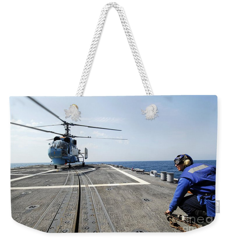 Horizontal Weekender Tote Bag featuring the photograph A Ukrainian Navy Ka-27 Helix Helicopter by Stocktrek Images