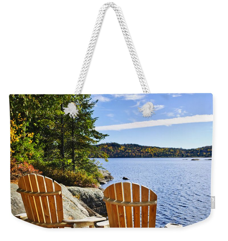Chairs Weekender Tote Bag featuring the photograph Adirondack Chairs At Lake Shore by Elena Elisseeva