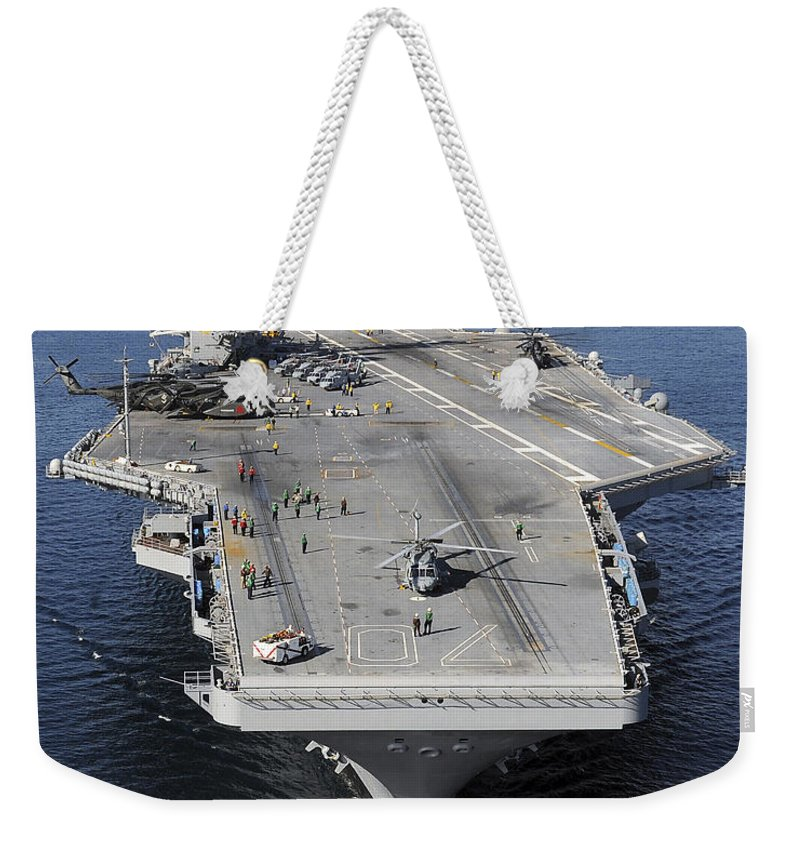 Humanitarian Relief Weekender Tote Bag featuring the photograph Aircraft Carrier Uss Carl Vinson by Stocktrek Images