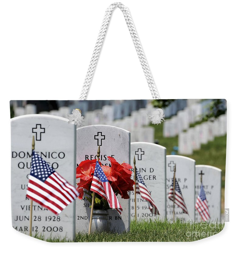 Memorial Day Weekender Tote Bag featuring the photograph American Flags Placed In The Front by Stocktrek Images