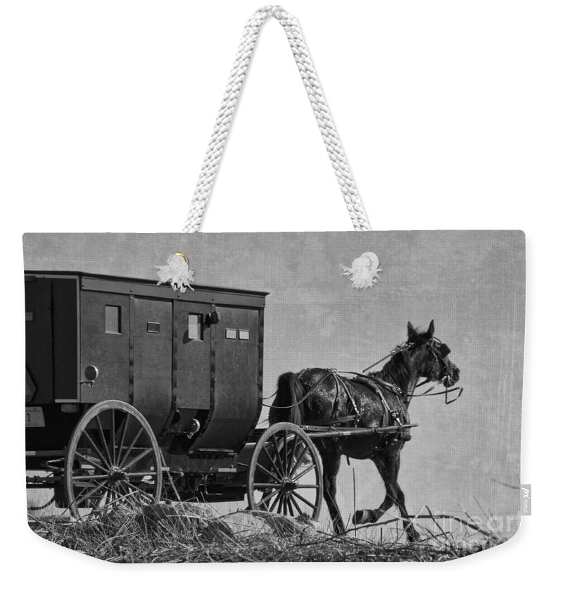Amish Weekender Tote Bag featuring the photograph Amish Buggy Black And White by David Arment