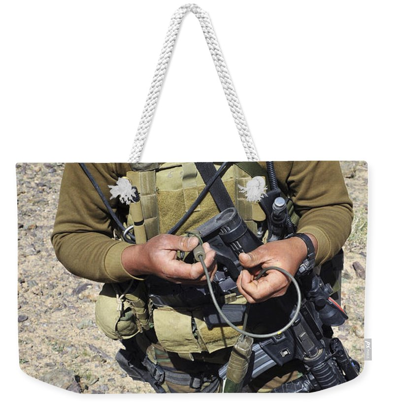 Afghanistan Weekender Tote Bag featuring the photograph An Afghan National Army Soldier by Stocktrek Images