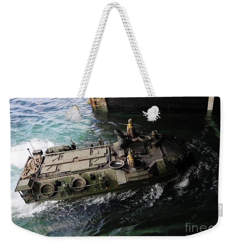 Amphibious Vehicles Weekender Tote Bag featuring the photograph An Amphibious Assault Vehicle Enters by Stocktrek Images