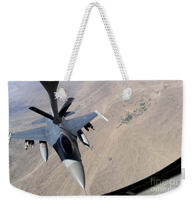 Afghanistan Weekender Tote Bag featuring the photograph An F-16 Fighting Falcon Receives Fuel by Stocktrek Images