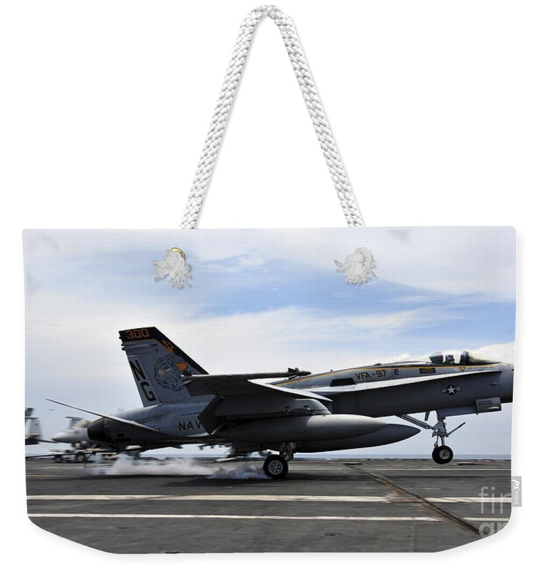 Flight Deck Weekender Tote Bag featuring the photograph An Fa-18c Hornet Lands Aboard by Stocktrek Images